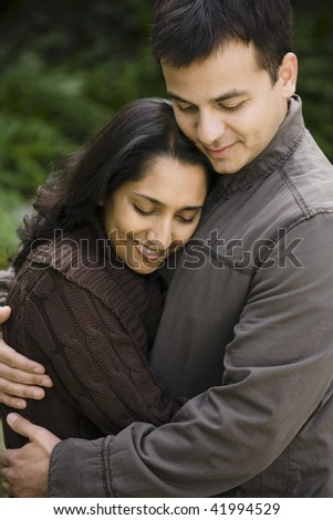 Portrait of a Young Indian Couple Standing Outdoors - stock photo