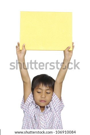 Portrait of a young kid holding a empty placard on his head against white background - stock photo