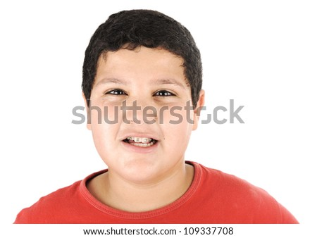 Portrait of a young kid with braces - stock photo
