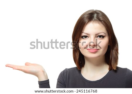 Portrait of a young lady presenting something on her hand on white background - stock photo