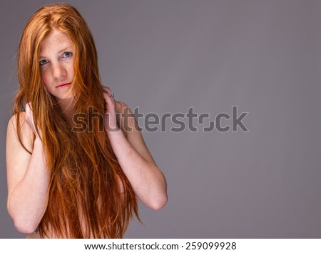 portrait of a young long ,ruddy haired woman - stock photo