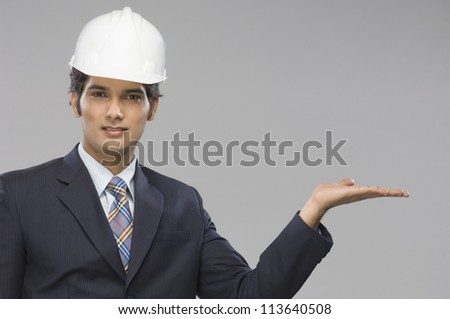 Portrait of a young male architect gesturing