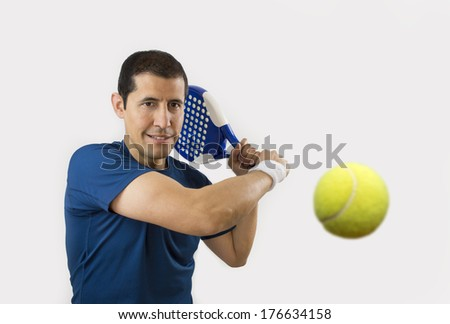portrait of a young male paddle tennis player  - stock photo