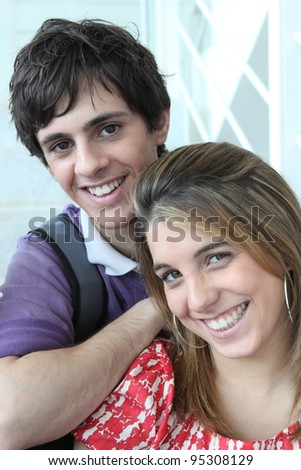 Portrait of a young man and woman - stock photo