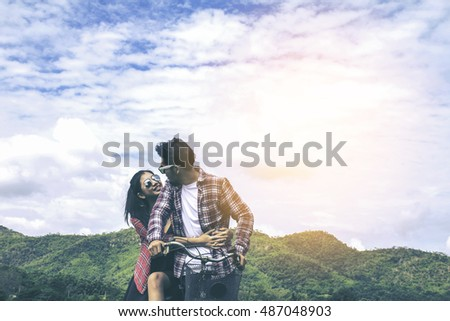 Portrait of A young man and woman couple tease and having fun at mountain, enjoy holiday, happy life.