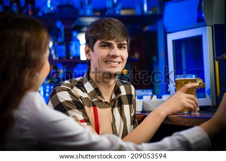 portrait of a young man at the bar, fun nightlife