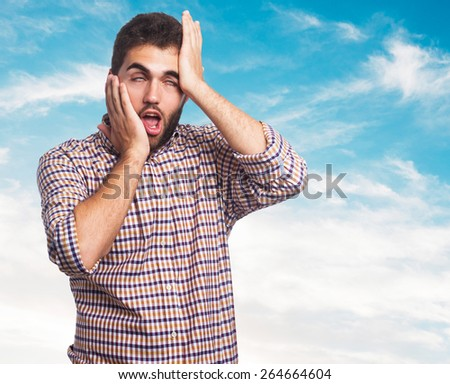 portrait of a young man doing a crazy gesture - stock photo
