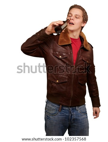 portrait of a young man drinking beer against a white background