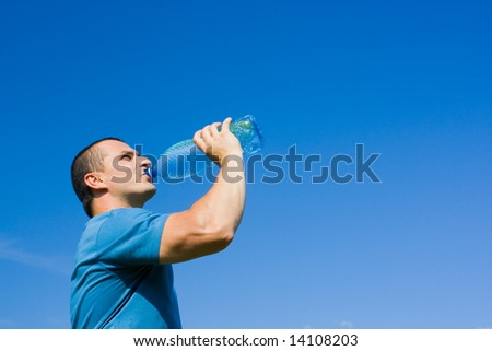 Portrait of a young man drinking water