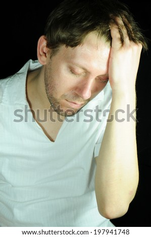 Portrait of a young man expressing pain  - stock photo