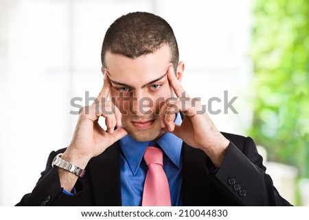 Portrait of a young man focusing his mind - stock photo