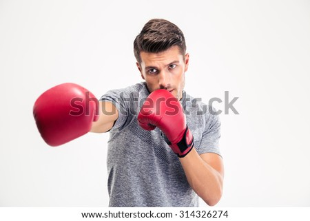 Portrait of a young man hitting at camera in boxing gloves isolated on a white background - stock photo