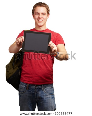 portrait of a young man holding a digital tablet over a white background