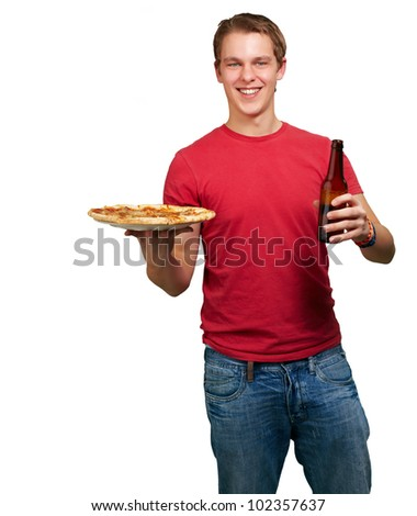 portrait of a young man holding a pizza and a beer over a white background