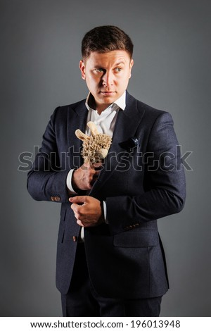 portrait of a young man holding  teddy bear