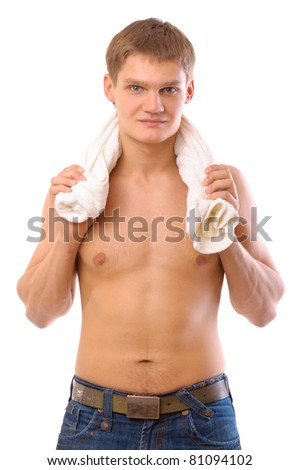 Portrait of a young man holding white towel - stock photo