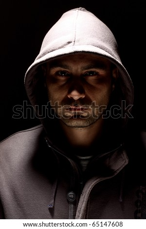 Portrait of a young man in a hood - stock photo