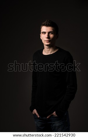 portrait of a young man in low key - stock photo
