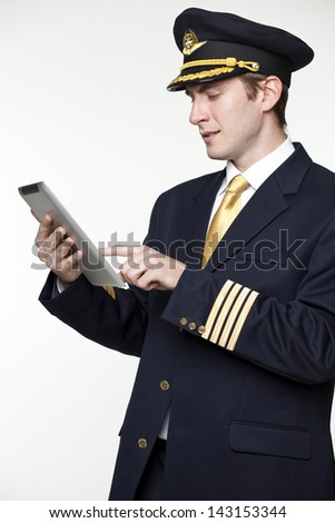 Portrait of a young man in the form of a passenger plane pilot - stock photo