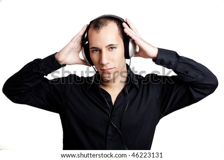 Portrait of a young man listening music with headphones