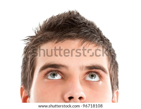 Portrait of a young man looking up - stock photo