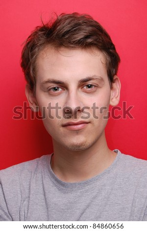 portrait of a young man on red