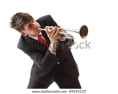 Portrait of a young man playing his Trumpet plays isolated white background - stock photo