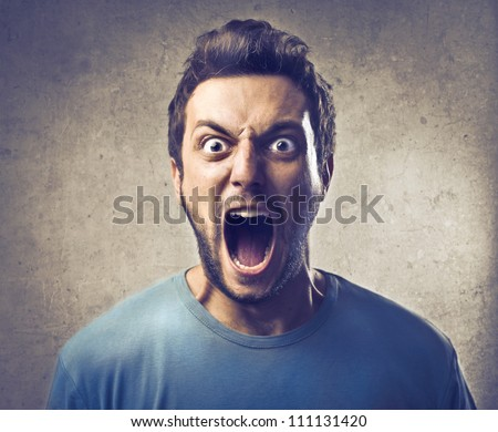 Portrait of a young man screaming - stock photo