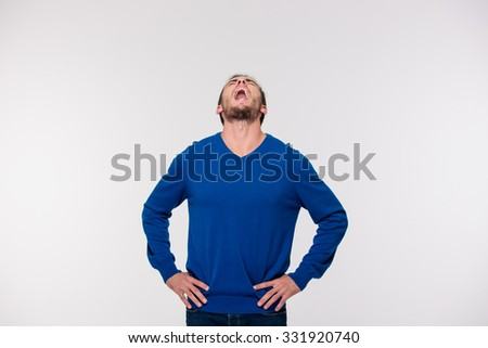 Portrait of a young man screaming isolated on a white background - stock photo