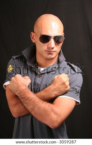 Portrait of a young man shaved head with sunglasses - stock photo