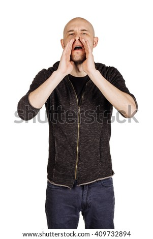 Portrait of a young man shouting loud with hands on the mouth. human emotion expression and lifestyle concept. image on a white studio background. - stock photo