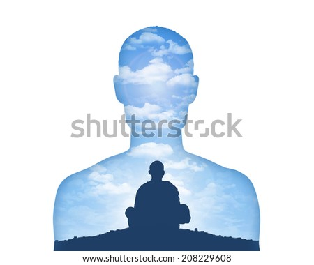 portrait of a young man showing his inner world as a monk meditating on a beautiful sky background - stock photo