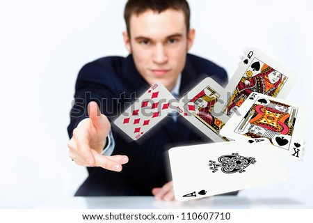 Portrait of a young man showing poker cards - stock photo