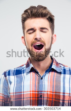 Portrait of a young man singing with closed eyes isolated on a white background - stock photo