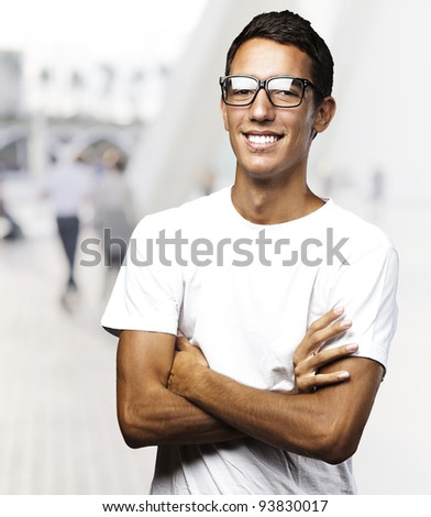 portrait of a young man smiling against a street background