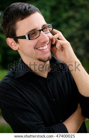 Portrait of a young man speaking on the phone