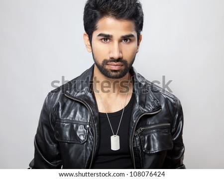 Portrait of a young man wearing a leather jacket - stock photo