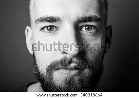 Portrait of a young man with a beard. Toned.