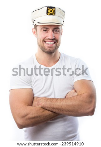 Portrait of a young man with a boat captain cap - stock photo