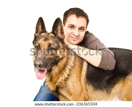Portrait of a young man with a German shepherd - stock photo