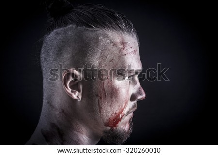 portrait of a young man with blood