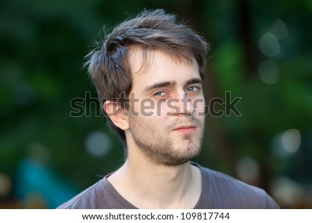 Portrait of a young man with blue eyes - stock photo
