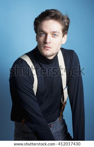 Portrait of a Young Man with Brown Hair with Suspenders.