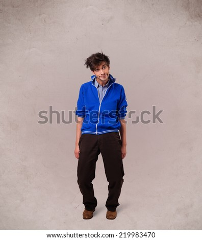 Portrait of a young man with empty copy space on grungy background - stock photo