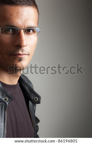 portrait of a young man with glasses