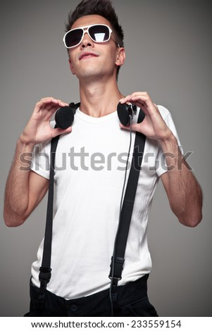 Portrait of a young man with headphones - stock photo