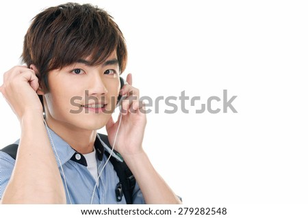 Portrait of a young man with headphones. - stock photo