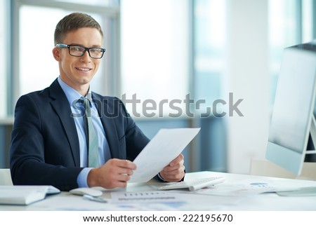 Portrait of a young manager at his workplace - stock photo