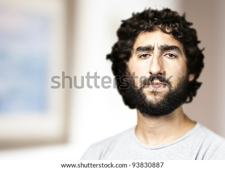 portrait of a young mans face in a house - stock photo