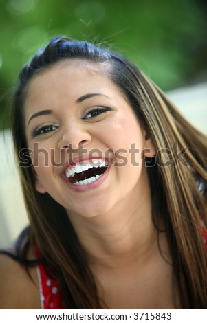 Portrait of a young mexican girl laughing